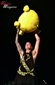 Austin Carlile from Of Mice & Men hanging with a giant gift from the crowd